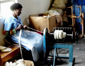 Mapusha Weaver spinning wool, South Africa | Hand Spun Hope, book