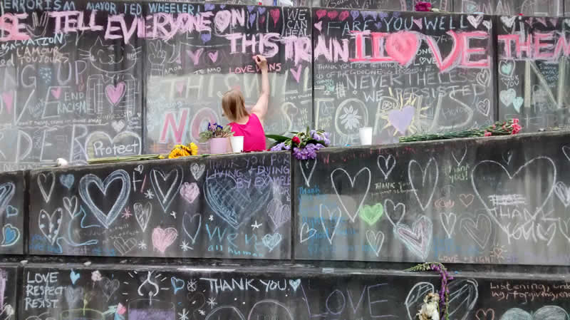Love written in chalk at the Hollywood MAX memorial